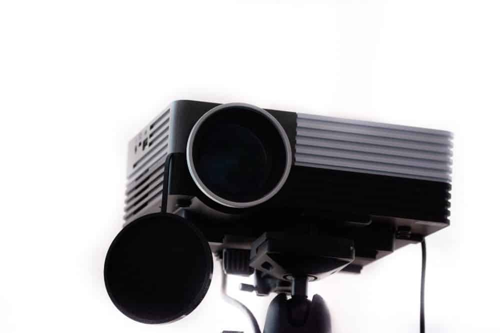 a black outdoor projector on a tripod