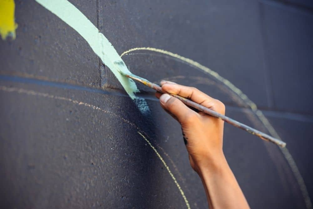a person painting on a traced line