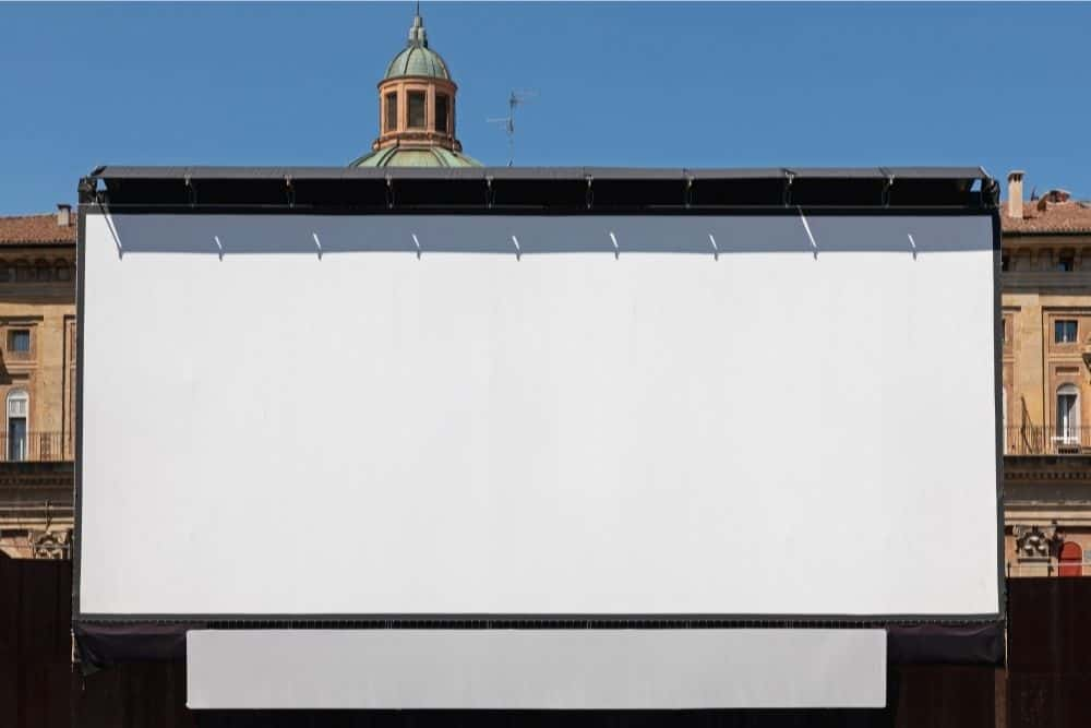 a projector screen placed outdoors