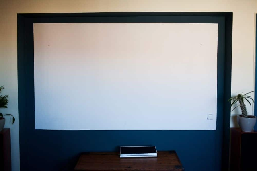 a white wall with dark border used as projector screen