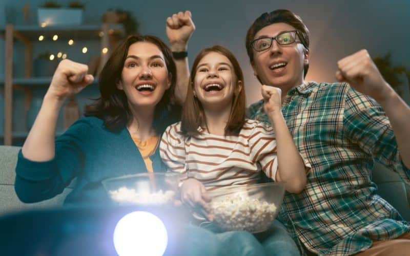 a family have fun watching movie