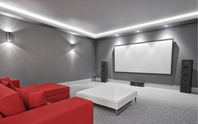 a home theater with projector and speaker