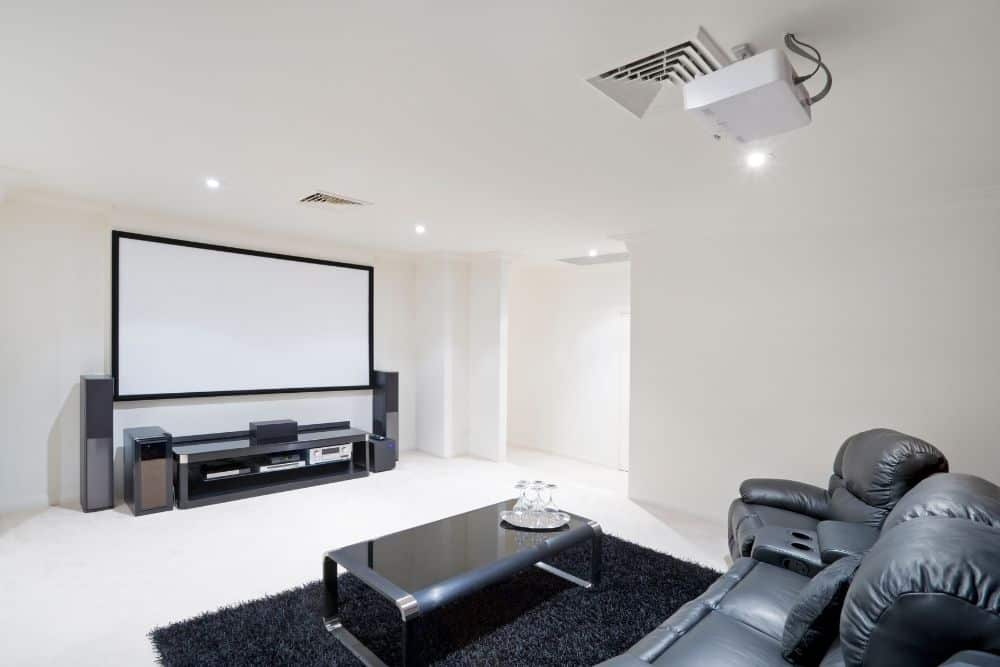 a home theater with projector on the ceiling