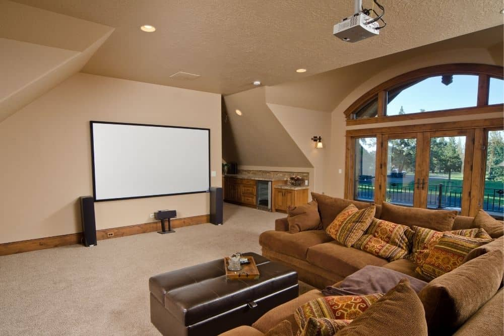 a home theater with projector