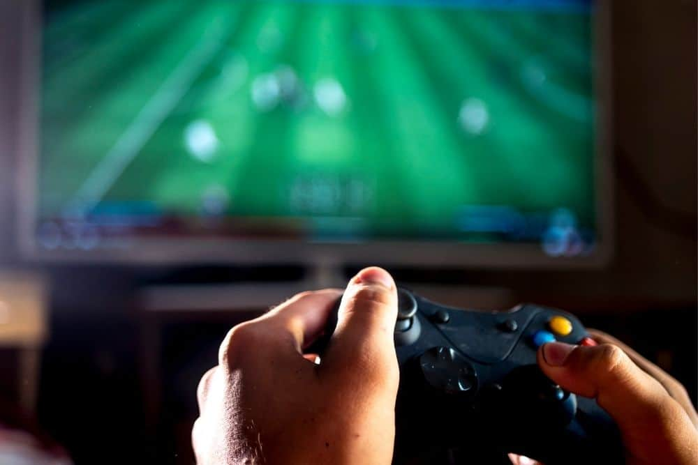a person playing game on TV