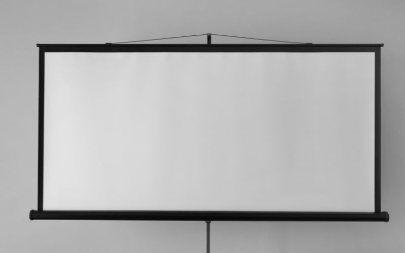 a projector screen is mounted without drilling