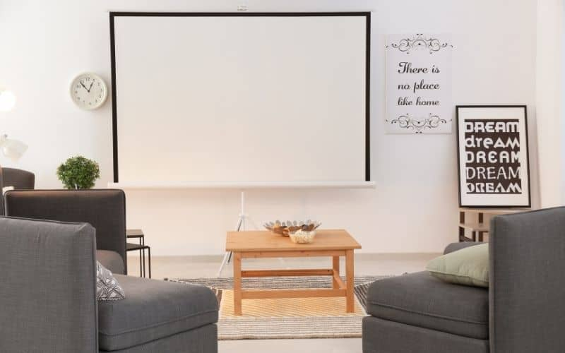 a projector screen placed in a bright room