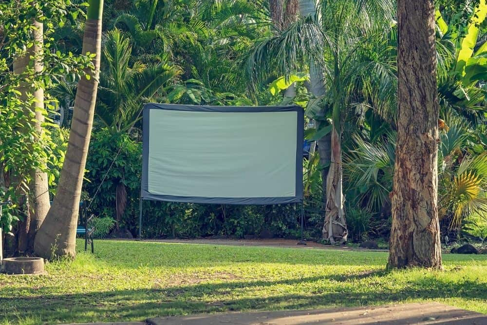 a projector screen placed in the yard