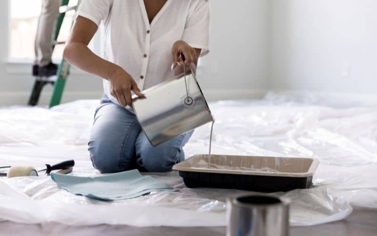 a woman enjoy making projector screen paint