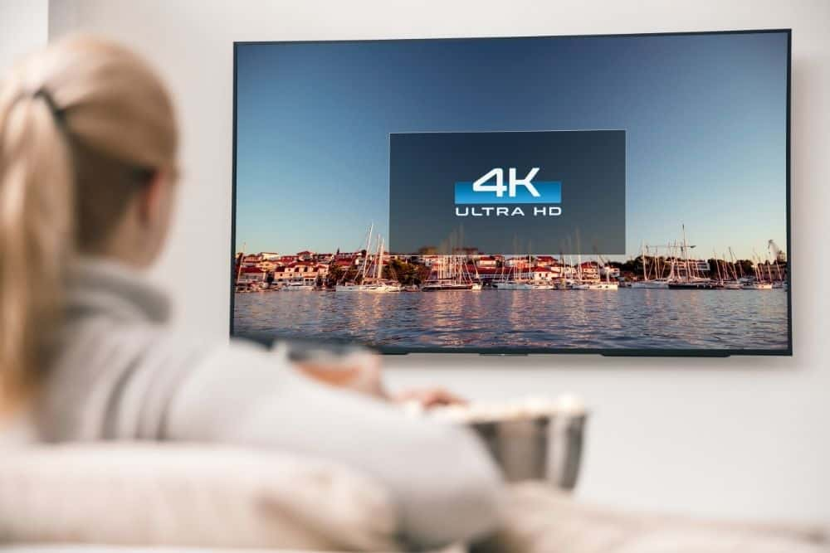 a woman starting 4K TV