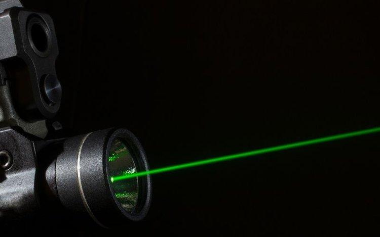 a gun transmitting laser light