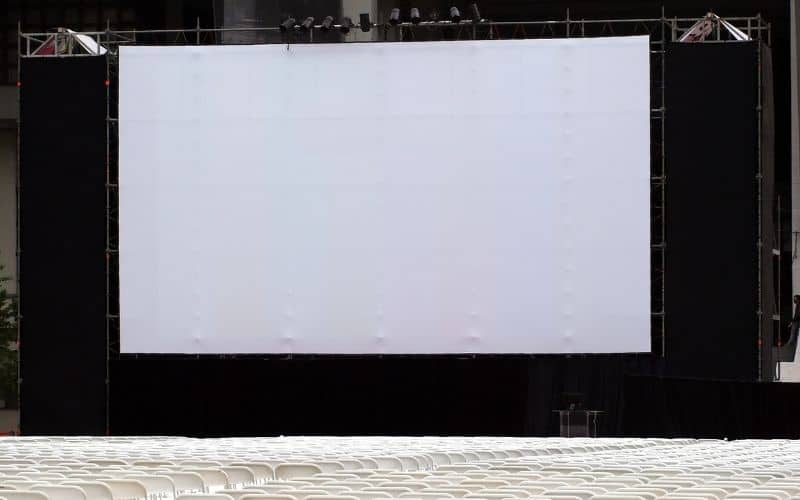 a large outdoor projector screen before the show