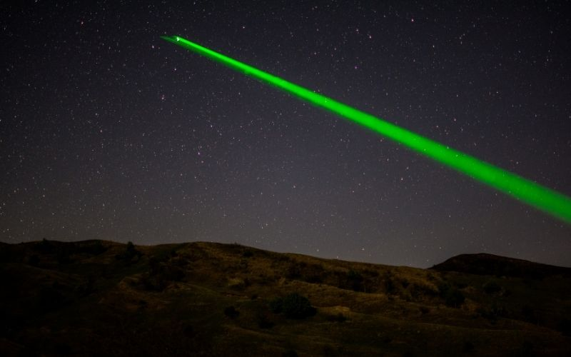 a strong laser light at night