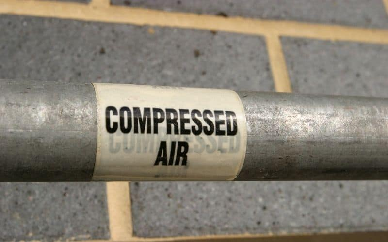 compressed air used for cleaning projector screen