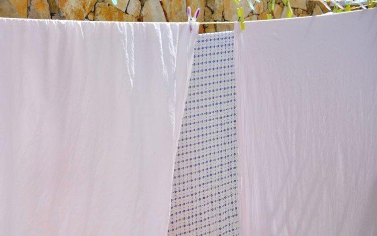 hanging white bed sheet