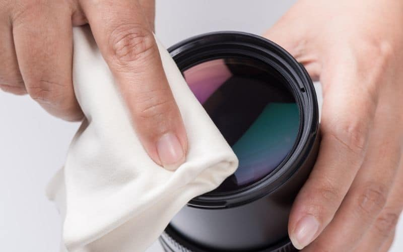 cleaning a projector lens using a soft towel
